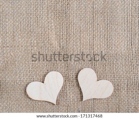 Valentine card with textile and heart on old wood