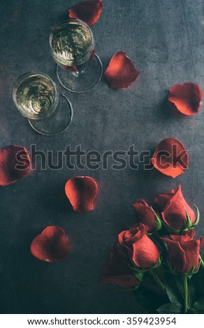 Valentine: Champagne Glasses With Roses And Petals - stock photo