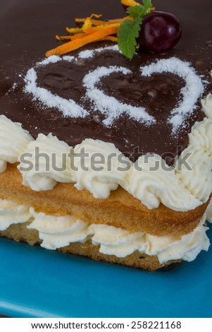 Valentine Chocolate icing cake with flower and hearts - stock photo