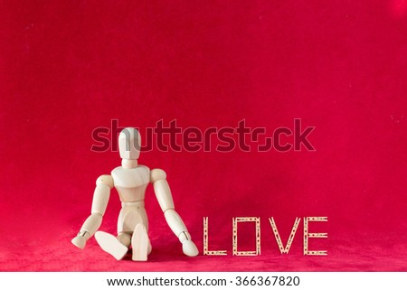 Valentine concept with wood figure and Caption word love made by clothes pin - stock photo