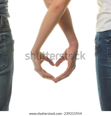 Valentine Couple in love showing Heart with their fingers. Love Concept. Valentines Day. - stock photo