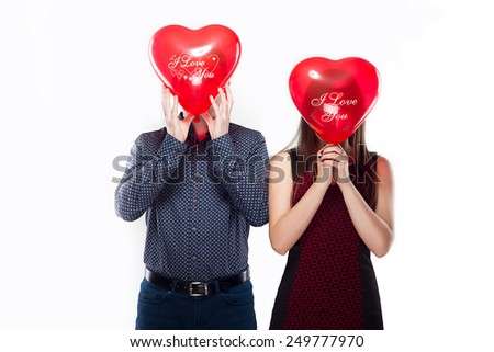 Valentine Couple. Portrait of Smiling Beauty Girl and her Handsome Boyfriend Happy Joyful Family. Love Concept. Heart Sign. Happy Lovers. Valentines Day