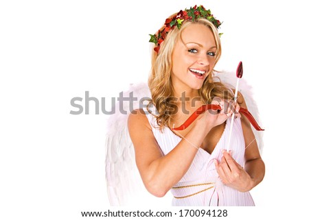 Valentine Cupid: Laughing with bow and arrow. - stock photo