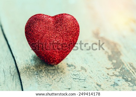 Valentine day background. heart on grunge wood background. vintage filter. - stock photo