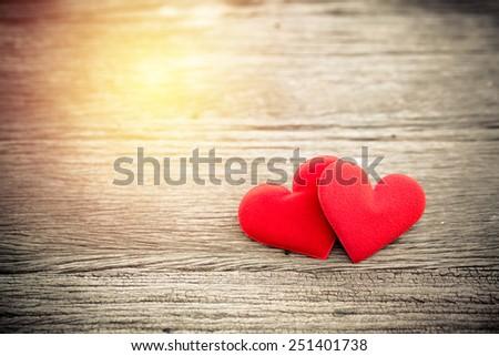 Valentine day background. red heart on grunge wood background. vintage filter. - stock photo