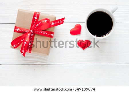 Valentine day background with gift and red hearts, top view