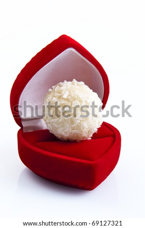Valentine day concept: candy in red heart-shaped velvet gift-box. Macro shot, isolated on white background - stock photo