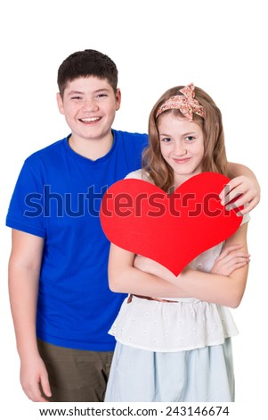 Valentine day concept. Portrait of a young lovely couple holding a heart in their hands. Love story.