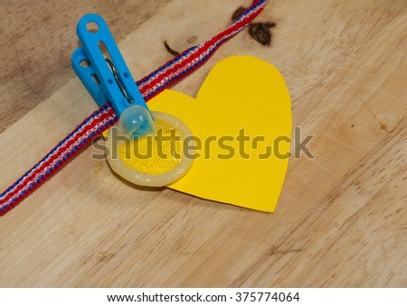 Valentine Day concept. Use condom for safety. - stock photo