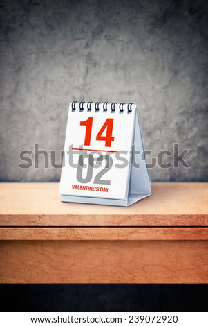 Valentine day date concept - February 14th on desk calendar at office table as a reminder of upcoming holiday. - stock photo