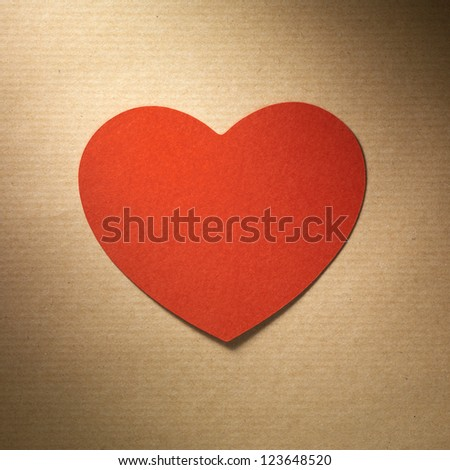 Valentine day heart made of paper on grunge paper background