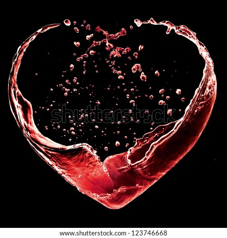 Valentine day heart made of red wine splash isolated on black background - stock photo