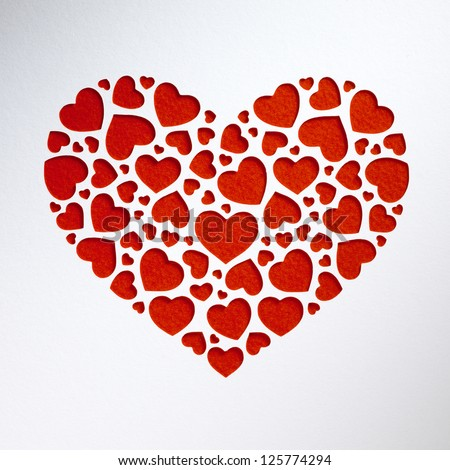 Valentine day heart made of small hearts on paper card - stock photo