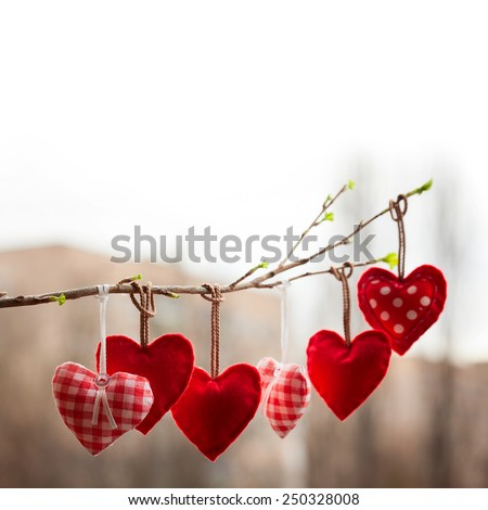 Valentine day love beautiful. Heart hanging on branch of tree on city street. Selective focus. Background blur bokeh - stock photo