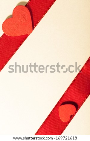 Valentine day. Red satin ribbon with heart. Copy space for text.