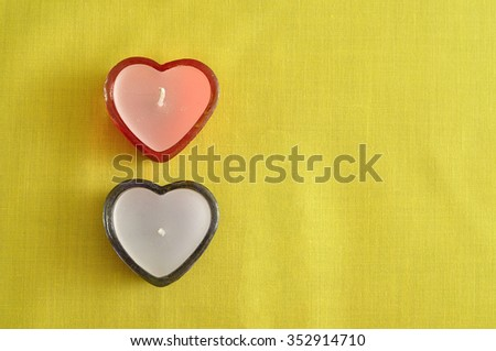 Valentine Day. Two heart shape candles.
