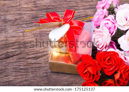 Valentine decoration, heart shaped chocolates box with blank card and bow decorated with roses
