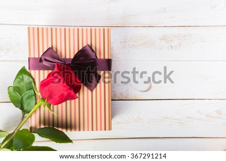 Valentine gift box and red rose