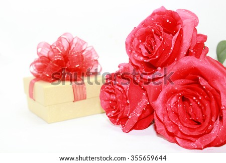 Valentine gift box and red roses