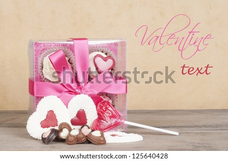 Valentine gift candy and bonbons background card design with room for your text - stock photo