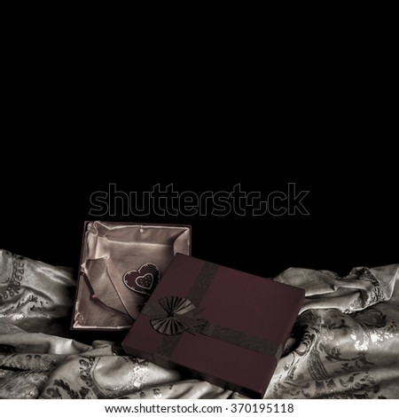 Valentine gift on black background with white space for message