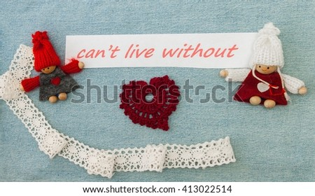 Valentine, greeting card with red quilling heart and  knitting couple in love. Lettering I canâ??t live without you on the denim background. Handmade concept. - stock photo