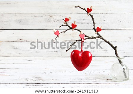 Valentine heart hanging on a tree branch - stock photo
