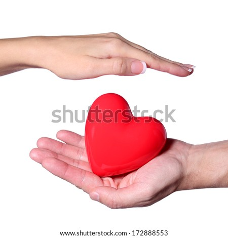 Valentine Heart in Female and Male Hands, isolated on white background. Love and Relationships Concept
