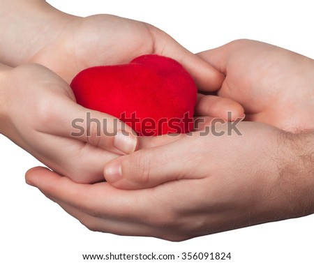 Valentine heart in man and woman hands isolated on white background - stock photo