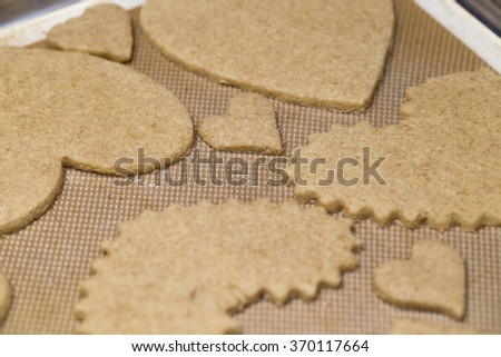 Valentine heart sugar cookies with different texture one is smooth edge while the other has no decoration of frosting or sprinkling - stock photo