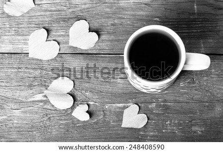 Valentine hearts and cup of tea on the old wooden table. Toned. - stock photo