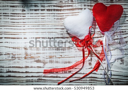 Valentine hearts with tapes on wooden board holidays concept.