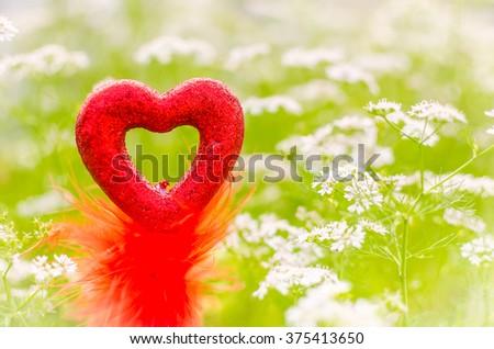 Valentine love symbol in floral green garden - stock photo