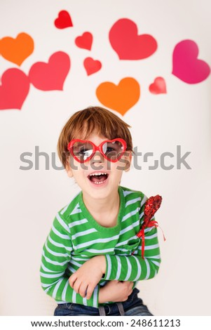 Valentine's Day arts, crafts and fun: hearts, heart-shaped glasses and toys, kids having fun, celebrate or party theme
