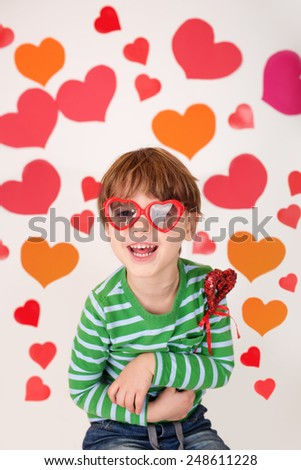 Valentine's Day arts, crafts and fun: hearts, heart-shaped glasses and toys, kids having fun, celebrate or party theme - stock photo