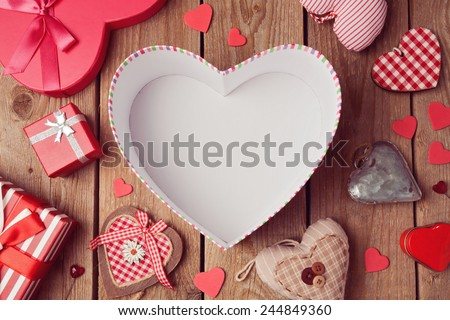 Valentine's day background with empty heart shape box on wooden table. View from above - stock photo
