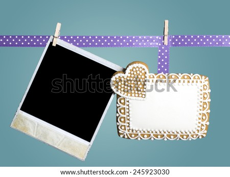 Valentine's day background with gingerbread and with picture frame. - stock photo