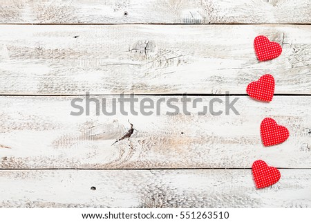 Valentine's day background with heart shapes on white wooden table, top view with copy space