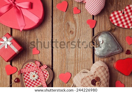 Valentine's day background with heart shapes on wooden table - stock photo