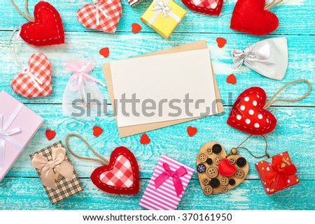 Valentine's day background with heart shapes on wooden table. Beautiful holiday invitation. Mock up for text. - stock photo