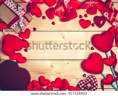 Valentine's day background with red hearts and gifts on wooden table.Place for your text.
