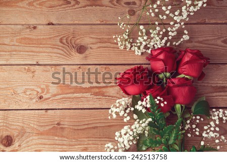 Valentine's day background with roses on wooden table. View from above - stock photo