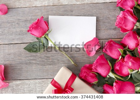 Valentine's day. Beautiful roses with a gift - stock photo