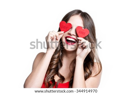 Valentine's Day. Beautiful young woman with heart in her hands.  - stock photo
