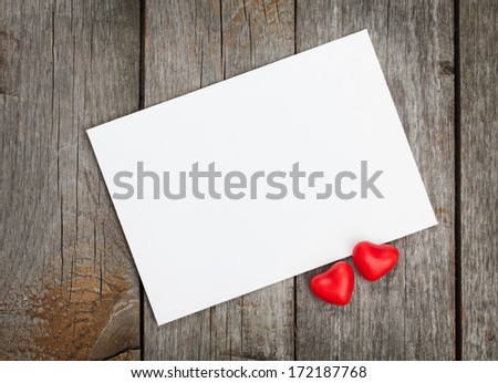 Valentine's day blank gift card and red candy hearts on wooden background - stock photo