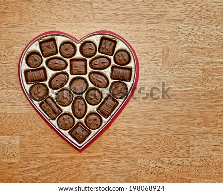 Valentine's Day bonbons in a heart-shaped box - stock photo
