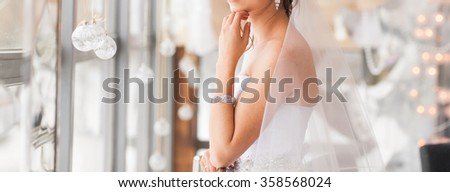 valentine's day, bridal, wedding, christmas, x-mas, winter, happiness concept - bride looking at window. - stock photo