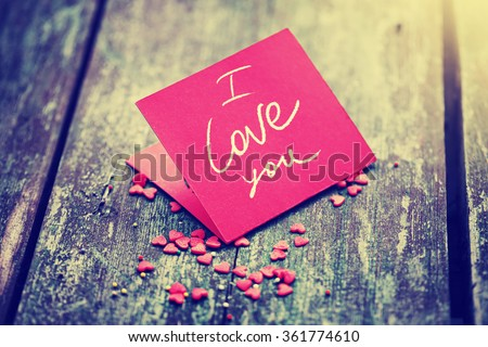Valentine's day card with small hearts on wooden background - stock photo