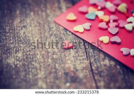 Valentine's day card with small hearts on wooden background/ romantic love background - stock photo