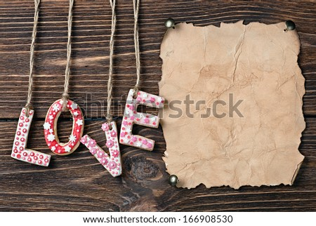 Valentine's Day cookies and old paper for congratulation - stock photo